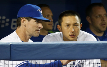 Mottolla attempting to tell Munenori Kawasaki how to pull a baseball. Kawasaki would later line a ball directly into the dugout, opposite field.