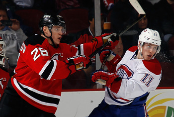Brendan Gallagher (right) of the Montreal Canadiens and Anton Volchenkov of the New Jersey Devils.
