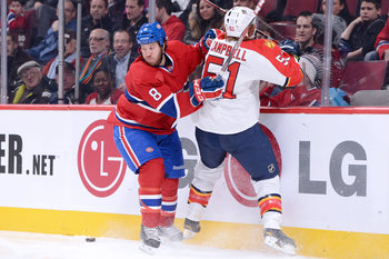 Montreal Canadien Brandon Prust checks Florida Panther Brian Campbell.