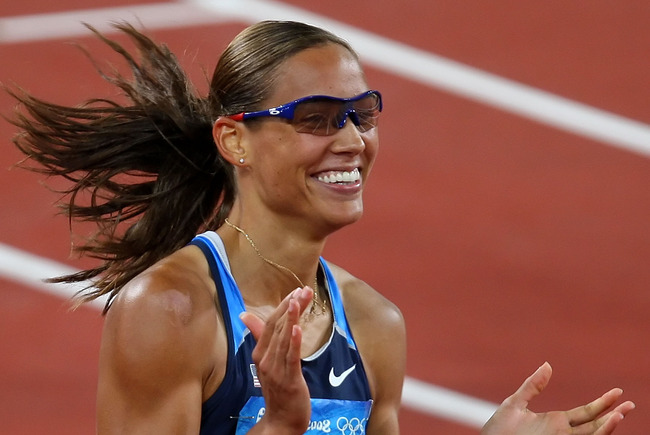 BEIJING - AUGUST 18:  Lolo Jones of the United States celebrates her qualification in the Women's 100m Hurdles Semi Final at the National Stadium on Day 10 of the Beijing 2008 Olympic Games on August 18, 2008 in Beijing, China.  (Photo by Phil Walter/Gett
