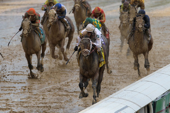 Borel and Super Saver squeeze through on the rail en route to winning the 2010 Kentucky Derby.