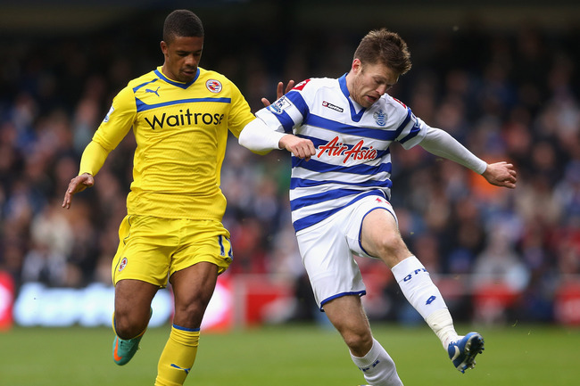 LONDON, ENGLAND - NOVEMBER 04:  Jamie Mackie of Queens Park Rangers is closed down by Garath McCleary of Reading during the Barclays Premier League match between Queens Park Rangers and Reading at Loftus Road on November 4, 2012 in London, England.  (Phot