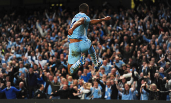 Captain fantastic Vincent Kompany celebrates his derby winner.