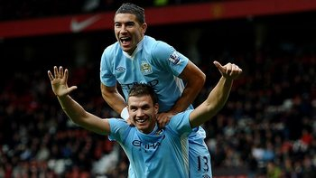 Edin Dzeko informs everyone how many goals City scored. (Getty Images)