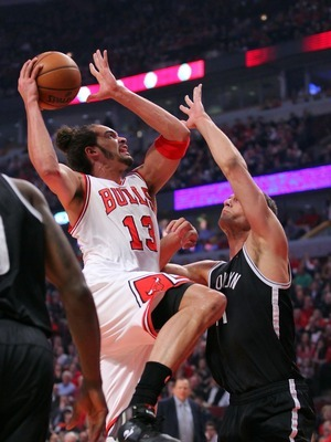 Apr 25, 2013; Chicago, IL, USA; Chicago Bulls center Joakim Noah (13) is defended by Brooklyn Nets center Brook Lopez (11) during the first quarter of the first round of the 2013 NBA playoffs at the United Center. Mandatory Credit: Dennis Wierzbicki-USA T