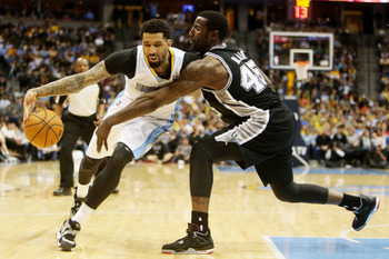 Apr 10, 2013; Denver, CO, USA;  Denver Nuggets forward Wilson Chandler (left) drives to the basket against San Antonio Spurs center DeJuan Blair (45) during the second half at the Pepsi Center.  The Nuggets won 96-86.  Mandatory Credit: Chris Humphreys-US