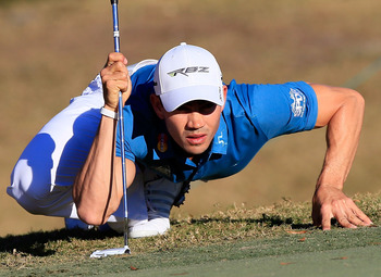 His Spiderman approach to checking out putts hasn't helped Villegas all that much.