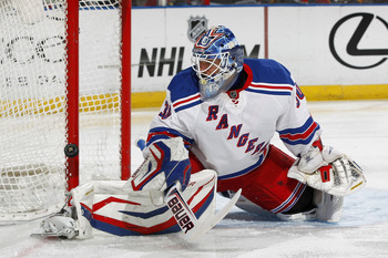 Henrik Lundqvist fights off a save.