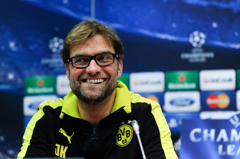 Plenty to smile about: Klopp and the Dortmund defence's offside trap was working like clockwork against Madrid on Wednesday, but all it takes is one defender to get it wrong for the whole plan to collapse