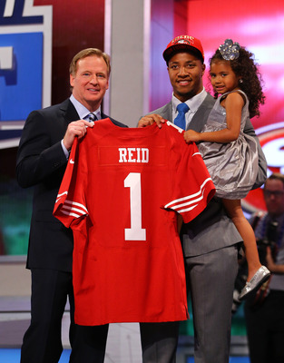 Eric Reid and his daughter pose with Roger Goodell after the 49ers traded up to grab him.