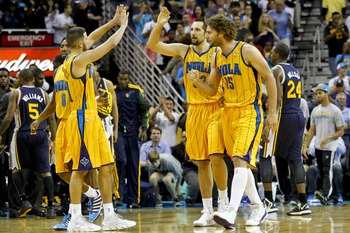 November 2, 2012; New Orleans, LA, USA; New Orleans Hornets point guard Greivis Vasquez (21), shooting guard Roger Mason Jr. (8), center Robin Lopez (15) celebrate  with power forward Ryan Anderson (33) after after a three pointer during the fourth quarte
