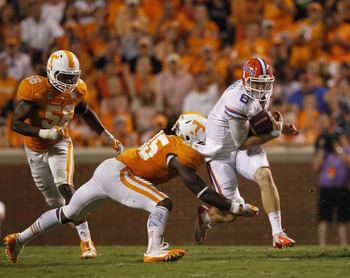 KNOXVILLE, TN - SEPTEMBER 15: Jeff Driskel #6  quarterback of the Florida Gators breaks free from A.J. Johnson #45 of the Tennessee Volunteers during the second half of play at Neyland Stadium on September 15, 2012 in Knoxville, Tennessee.    (Photo by Jo