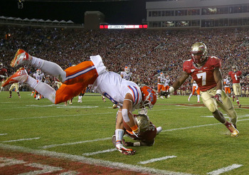 TALLAHASSEE, FL - NOVEMBER 24:  Trey Burton #8 of the Florida Gators is forced out of bounds by Terrence Brooks #31 of the Florida State Seminoles during a game  at Doak Campbell Stadium on November 24, 2012 in Tallahassee, Florida.  (Photo by Mike Ehrman