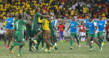 Burkina Faso celebrate reaching the final after beating Ghana on penalties.