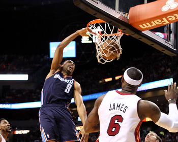 MIAMI, FL - MARCH 24:  Forward LeBron James #6 of the Miami Heat watches a dunk by Guard Gerald henderson #9 of the Charlotte Bobcats at American Airlines Arena on March 24, 2013 in Miami, Florida. NOTE TO USER: User expressly acknowledges and agrees that