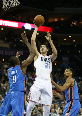 CHARLOTTE, NC - MARCH 08:  Byron Mullens #22 of the Charlotte Bobcats shoots over Serge Ibaka #9 of the Oklahoma City Thunder during their game at Time Warner Cable Arena on March 8, 2013 in Charlotte, North Carolina. NOTE TO USER: User expressly acknowle