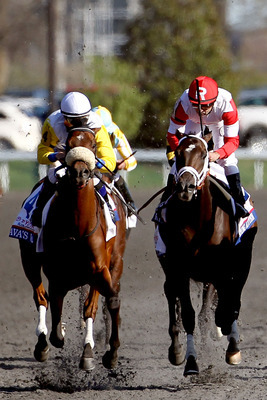 Java's War, left, wins the Blue Grass Stakes by a neck.