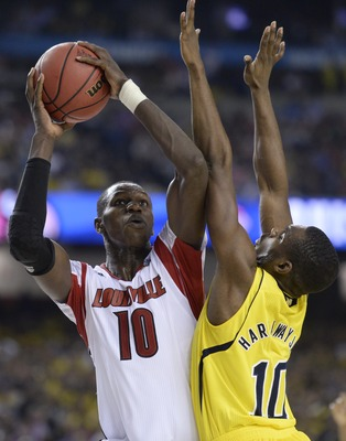 Apr 8, 2013; Atlanta, GA, USA; Louisville Cardinals center Gorgui Dieng (10) shoots against Michigan Wolverines guard Tim Hardaway Jr. (10) during the second half of the championship game in the 2013 NCAA mens Final Four at the Georgia Dome.  Mandatory Cr