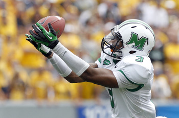 PITTSBURGH, PA - SEPTEMBER 01:  Aaron Dobson #3 of the Marshall Thundering Herd catches a pass against the West Virginia Mountaineers during the game on September 1, 2012 at Mountaineer Field in Morgantown, West Virginia.  (Photo by Justin K. Aller/Getty