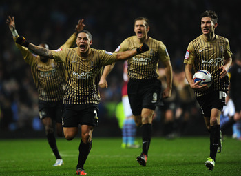 Bradford celebrate beating Aston Villa, sealing a trip to Wembley Stadium.