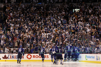 Canucks celebrate an overtime goal at Rogers Arena.