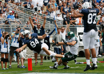 STATE COLLEGE, PA - SEPTEMBER 01: Matt Lehman #84 of the Penn State Nittany Lions lepas into the end zone in for a touchdown in front of Josh Kristoff #9 of the Ohio Bobcats after catching a pass during the second quarter at Beaver Stadium on September 1,