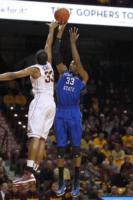 Nov 15, 2012; Minneapolis, MN, USA; Tennessee State Tigers forward Robert Covington (33, right) shoots over Minnesota Golden Gophers forward Rodney Williams Jr. (33) during the first half at Williams Arena. Mandatory Credit: Brace Hemmelgarn-USA TODAY Spo