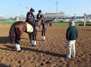 Orb prepares for the Kentucky Derby as trainer Shug McGaughey looks on