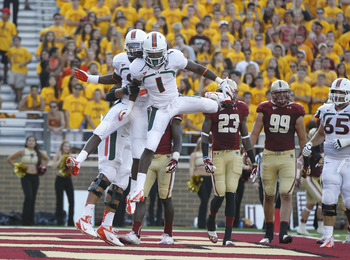 Sep 1, 2012; Chestnut Hill, Massachusetts, USA; Miami Hurricanes wide receiver Malcolm Lewis (9) celebrates with wide receiver Allen Hurns (1) after scoring a touchdown during the fourth quarter against the Boston College Eagles at Alumni Stadium. Miami H