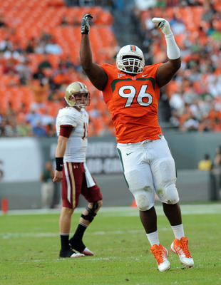 Nov 25, 2011; Miami, FL, USA; Miami Hurricanes defensive lineman Curtis Porter (96) celebrates and making a tackle during the first half against the Boston College Eagles at Sun Life Stadium. Mandatory Credit: Steve Mitchell-USA TODAY Sports
