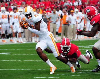 ATHENS, GA - SEPTEMBER 29: Justin Hunter #11 of the Tennessee Volunteers runs with a catch against Branden Smith #1 of the Georgia Bulldogs at Sanford Stadium on September 29, 2012 in Athens, Georgia. (Photo by Scott Cunningham/Getty Images)