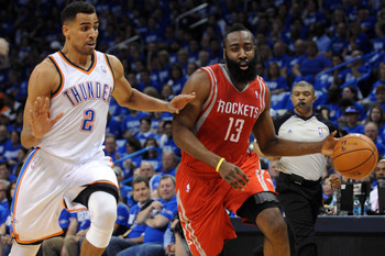 Apr 21, 2013; Oklahoma City, OK, USA; Houston Rockets guard James Harden (13) handles the ball against Oklahoma City Thunder guard Thabo Sefolosha (2) in the first half during game one of the first round of the 2013 NBA Playoffs at Chesapeake Energy Arena