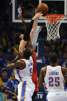 May 1, 2013; Oklahoma City, OK, USA; Houston Rockets center Omer Asik (3) attempts a dunk against Oklahoma City Thunder center Kendrick Perkins (5) during the second half in game five of the first round of the 2013 NBA Playoffs at Chesapeake Energy Arena.