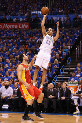 OKLAHOMA CITY, OK - MAY 01:  Kevin Martin #23 of the Oklahoma City Thunder puts up a shot over Carlos Delfino #10 of the Houston Rockets during the first half of Game Five of the Western Conference Quarterfinals of the 2013 NBA Playoffs at Chesapeake Ener