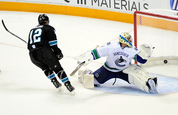 Patrick Marleau scores against the Canucks in the 2011 playoffs