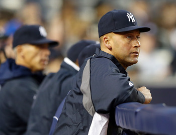 Derek Jeter watches from the bench as his Yankees contend without him.