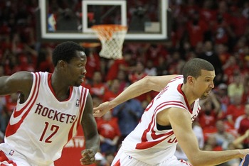 Apr 29, 2013; Houston, TX, USA; Oklahoma City Thunder point guard Reggie Jackson (15) and Houston Rockets shooting guard Francisco Garcia (32) and point guard Patrick Beverley (12) chase a loose ball in the fourth quarter in game four of the first round o