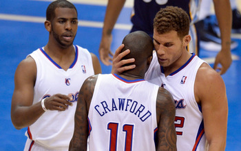Apr 22, 2013; Los Angeles, CA, USA; Los Angeles Clippers power forward Blake Griffin (32) hugs teammate Jamal Crawford after he was fouled during 2nd quarter action in game two in the first round of the 2013 NBA playoffs at Staples Center. Left is Clipper