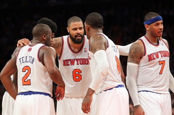 May 1, 2013; New York, NY, USA; New York Knicks guard Raymond Felton (2) and forward Iman Shumpert (21) and center Tyson Chandler (6) and guard J.R. Smith (8) and forward Carmelo Anthony (7) huddle after a timeout during the fourth quarter of game five of