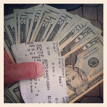 LOUISVILLE, KY - MAY 5: (EDITOR'S NOTE: Image was shot with a cellular phone using Instagram)  A detail of money and a winning ticket during the 138th running of the Kentucky Derby on May 5, 2012 at Churchill Downs in Louisville, Kentucky.(Photo by Jamie