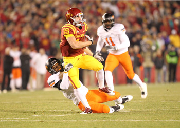 AMES, IA - NOVEMBER 18:  Josh Lenz #19 of the Iowa State Cyclones is tackled by Matthew Thomas #8 of the Oklahoma State Cowboys at Jack Trice Stadium November 18, 2011 in Ames, Iowa.  (Photo by Reese Strickland/Getty Images)