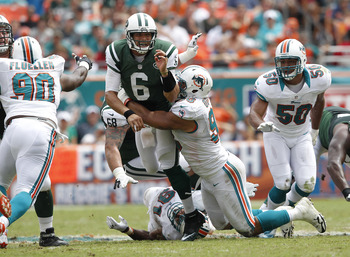 Odrick tackling Mark Sanchez