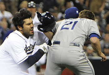 Carlos Quentin of the Padres hits Zack Greinke, breaking his collarbone.