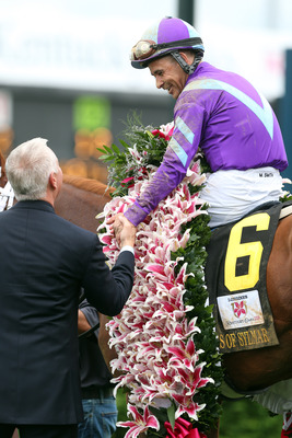 Mike Smith winning the Kentucky Oaks on Friday.