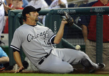 Konerko slides in foul territory, but can't come up with the catch. Brad Mills-USA TODAY Sports