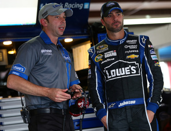 Chad Knaus and Johnson talking shop.