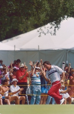 Hale Irwin celebrates after sinking a 45-foot putt on the 72nd hole of the 1990 U.S. Open.