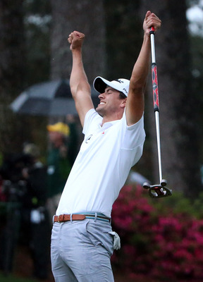 Adam Scott reacts to his 2013 Masters winning putt on the second playoff hole.
