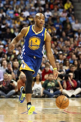 Apr 23, 2013; Denver, CO, USA; Golden State Warriors point guard Jarrett Jack (2) controls the ball during the first quarter against the Denver Nuggets during game two in the first round of the 2013 NBA playoffs at the Pepsi Center. The Warriors won 131-1