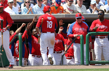 March 22, 2013; Clearwater, FL, USA; Philadelphia Phillies left fielder Darin Ruf (18) is congratulated by teammates  after he scored a run during the fourth inning against the Atlanta Braves at Bright House Networks Field. Mandatory Credit: Kim Klement-U